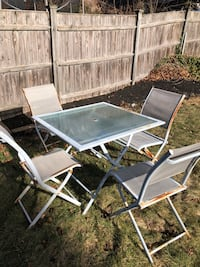 white metal framed glass top patio table Malden, 02148