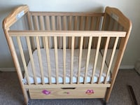 baby's brown wooden crib Green Bay, 54304