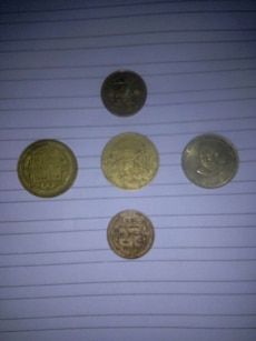 five silver and gold coins