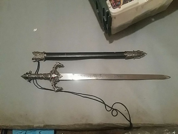 gray handled sword with scabbard