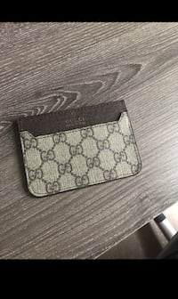 Gray and black monogrammed gucci wallet Toronto, M1E