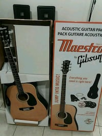 brown and black classical guitar 540 km