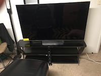 black flat screen TV and black wooden TV stand Longmont, 80504