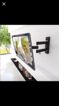 "New in box full motion swivel and tilt tv wall mount 60"" maximum San Diego, 92120"