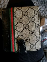 black and green Gucci wallet