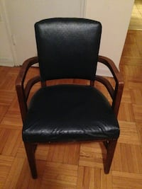 black wooden framed black leather padded armchair