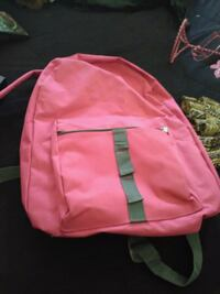 pink and black Nike backpack 1072 mi