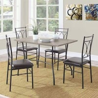 rectangular brown table with four black chairs dining set Houston, 77092