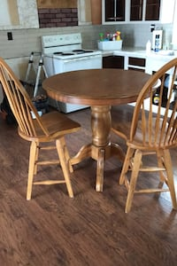 Oak pub height table and 4 swivel chairs.  Lunenburg, 01462
