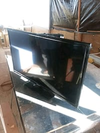 black flat screen TV with remote Beaumont, 92223