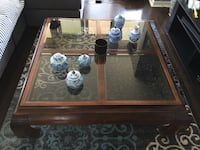 brown wooden framed glass top coffee table Toronto, M9C