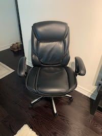 Black rolling office / desk chair