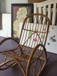 brown wooden framed padded armchair 284 mi