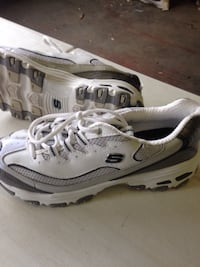 pair of gray-and-white Nike running shoes Knoxville, 21758