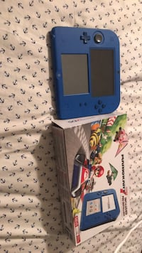 Blue nintendo ds with game cartridge New York, 11234