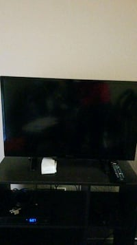black flat screen TV with remote Avondale, 85323