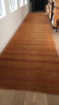 brown and red striped runner rug