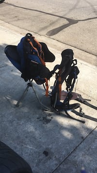 baby's black and orange travel system