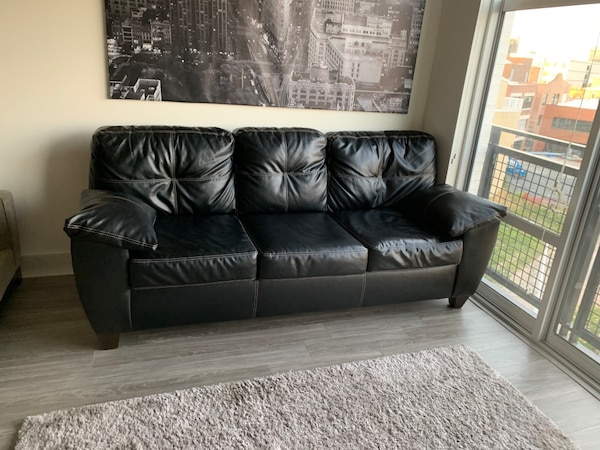 Gently used Black leather couch