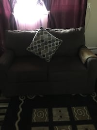 Black 2-seat couch Calgary, T2E 0T3