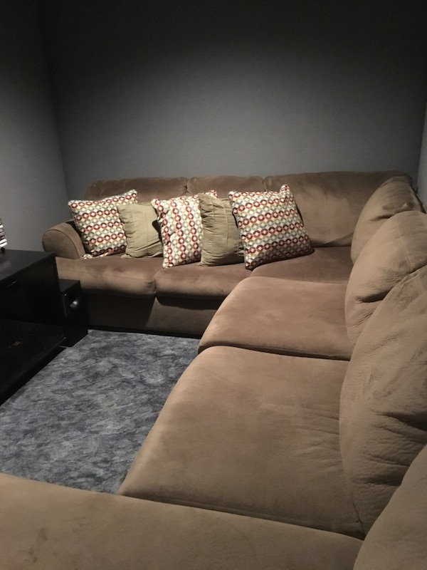 Used Brown microfiber sectional sofa with throw pillows for ...