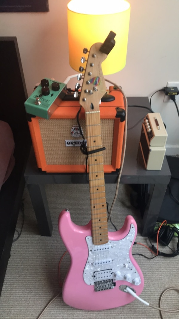custom fender strat with orange amp and delay pedal comes with tuner