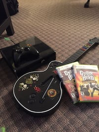Xbox 360 console with one controller, Guitar hero controller and games Waterloo, N2L 3P8