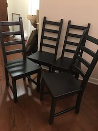 Four black dining chairs. Washington, 20037