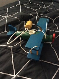 blue, yellow, green and red wooden airplane toy Killarney, R0K