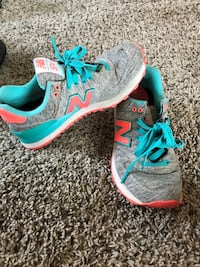 pair of gray-and-teal Nike running shoes San Marcos, 78666