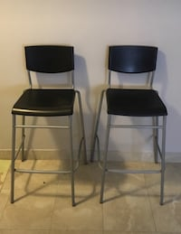 two black leather padded bar stools Vancouver, V6A 2C1