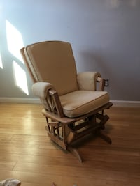 Brown wooden framed padded glider chair