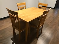 rectangular brown wooden table with four chairs dining set Brossard, J4Y 2J6