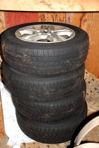 4 like new All Season 205 60 R16 Tires on Honda alloy rims