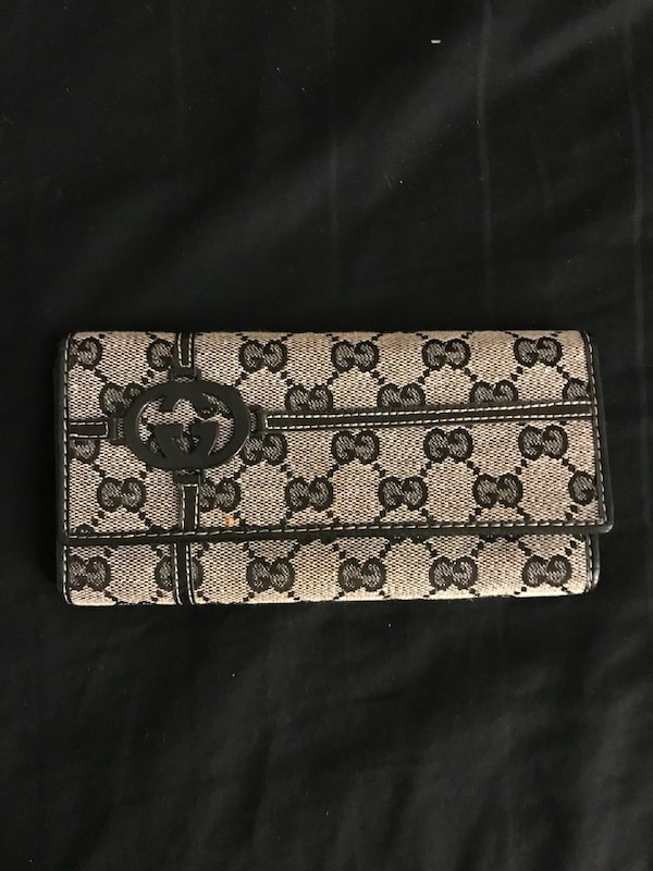 6febfc064ec Used monogrammed black and brown Gucci long wallet for sale in Woburn -  letgo