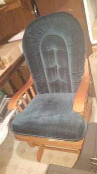 gray fabric padded wooden armchair