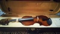 brown and black violin with case null