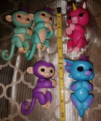 Group of Fingerlings ($20 for all five) Barrie all move and have sound.