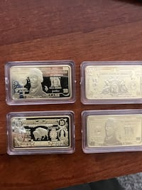 Four gold plated clad  1 ounce bars