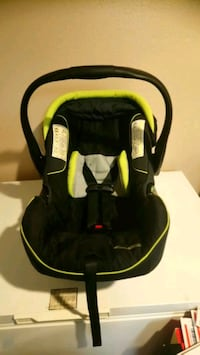 baby's black and yellow car seat carrier Houston, 77099