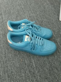pair of teal Nike running shoes