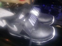 pair of black Nike basketball shoes size 12 little New York, 10027