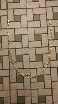 gold-colored clear gemstone encrusted chain necklace