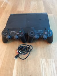 Svart Sony PS3 Super Slim konsol med kontroller Huddinge, 143 32