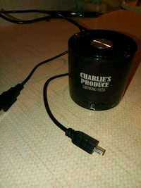cylindrical black Charlie's Produce portable speaker