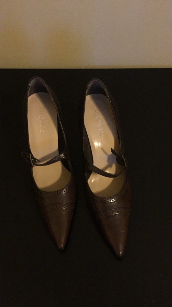 pair of brown leather pointed-toe flats