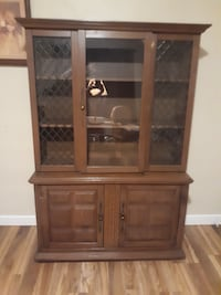 brown wooden framed glass display cabinet Anderson