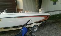 white and brown speedboat on trailer