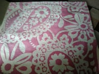 white and pink floral textile 2409 mi