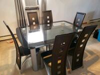 Glass dining room table set w/ lower storage area North Bellmore